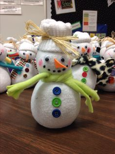 Sock snowmen! This is my students Christmas gifts to their parents. Very simple to make. Each kid needs one all white sock, and will fill it with 3 cups of either rice or barley. Take a rubber band and tie it off. Roll down the extra sock for hat. Hot glue down to keep in place. Decorate snowmen with buttons, googly eyes, scarf, orange foam triangle for a nose, and use a black sharpie for mouth. Add a little pink pastel or blush for rosy cheeks. Students loved making them!
