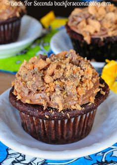Chocolate Butterfinger Cupcakes - I declare these the best cupcakes on the planet! Everyone loves them! http://backforseconds.com #butterfinger #cupcakes #candy #chocolate