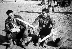 """Robert Mitchum and Jeffrey Hunter try the local baguette on the location of """"The Longest Day"""", directed by Ken Annakin. Classic Hollywood, Old Hollywood, Le Jour Le Plus Long, Omaha Beach, Jeffrey Hunter, History Online, Long Day, Famous Men, Back In Time"""