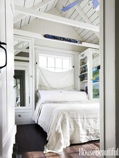 Small bedroom with built-in closets & vaulted planked ceilings