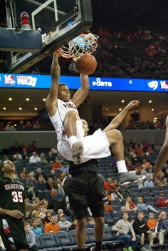 Justin Anderson throws down a two-handed slam dunk as the Virginia Cavaliers beat the Seattle Redhawks.