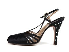 1950s | Salvatore Ferragamo | Lady's black satin sling back shoes, decorated with large rhinestones on the heels.