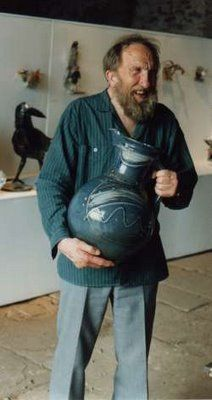"Michael ""Mick"" Casson holding one of his large pottery jugs."