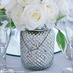 Glass hobnail jar in mercury silver with black hanger. Use for table decor, aisle lighting, or as votive candle holders. Measures 6.5 inches tall and 4.5 inches in diameter.