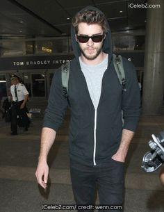 Liam Hemsworth  arrives at Los Angeles International Airport (LAX) http://icelebz.com/events/liam_hemsworth_arrives_at_los_angeles_international_airport_lax_/photo1.html