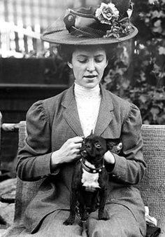 """Annie M. Nolan seated with her toy Boston Terrier, """"Massa."""""""