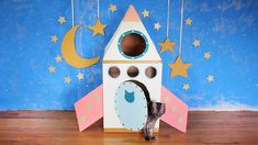 Get ready for blast off because we're pretty sure you're going to find this cardboard rocket ship out of this world. Just a couple of boxes, some paint and a few hours is all it takes to send kitty over the moon about her new digs. Cardboard Crafts Kids, Cardboard Rocket, Cardboard Cat House, Cardboard Box Crafts, Cardboard Toys, Paper Crafts, Cardboard Fireplace, Cardboard Playhouse, Cardboard Furniture