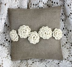 A sweet little pillow, 100% rustic linen, 100% wool yarn roses hand stitched to the front.