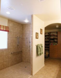 No curb and no door makes this shower very easy to use for anyone, but especially for a wheelchair-bound person.  A shower head on a slider bar plus grab bars placed for functional use gives the user a pleasant experience.