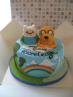 This was soooooo much fun to make. The cake is vanilla cake with vanilla butter cream and strawberry jam. Jake and Finn are sculpted from rice crispie treats and everything is fondant covered. ALGE...
