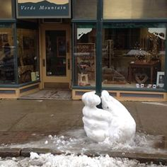 This subtle sign-holder. | 29 Seriously Cool Snow Sculptures That Will Make You Want Another Storm