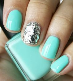 Not really a tutorial...But its again, a really cute idea! You can simply do this by painting a solid base coat on all of your fingers & on one of those fingers (whichever one u like) cover it in sparkles! This is such a cute & easy idea! :) XO, Glamor101