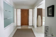 an excellent modern wooden door with side windows for modern classy house with concrete tile flooring also brown rug