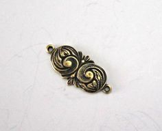 SAVE 10% use coupon code PIN10 Art Nouveau oxidized #brass stamping #connector, great for many different jewelry designs.   Quantity: 1  Size: 16mm length  ITEM#: 2ANC-V5-16    http://lilczechtreasures.ets... #supplies