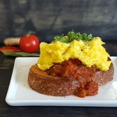 Akoori on buttered toast. BOOM. Soft-scrambled farm-fresh eggs on top of ginger, chile, red onion, fresh #turmeric and chopped garlic, tomato sauce.