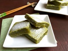 Matcha (Green Tea) Mochi Bars are squares of matcha green tea flavored rice cake bars that are sweet, chewy, sticky, with a very thin and light crunchy crust. #matcha #snack #mochi
