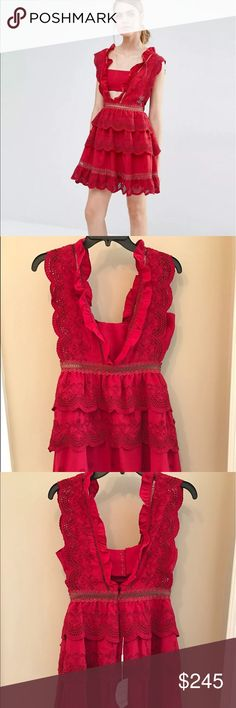 Self portrait 3 tiered peplum lace dress US 2 UK 6 Plunging neckline and back are framed by ruffle detail and ladder trim insert. A built-in bandeau is in place for concealment without being too covered up. Extended arm holes are emphasized by a scalloped edge. - Color: Raspberry Red - 70% Polyester 30% Cotton Authenticity guaranteed. Gorgeous dress! Unfortunately it's too big for me and I had to give up. Retail $445. Ask any questions before purchase. All sales are final. No returns. Self…