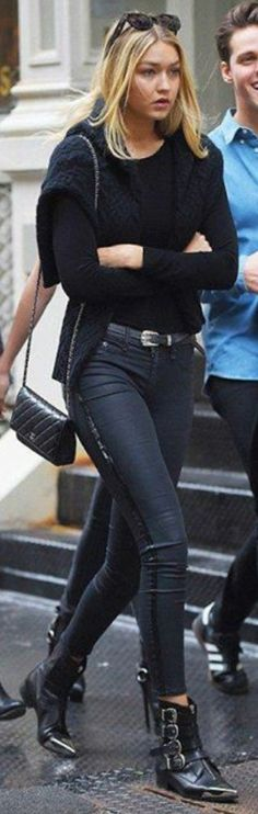 932baed75817a2 Gigi Hadid wearing Chanel Wallet on a Chain and Diesel Black Gold Metal Toe  Leather Boots