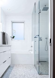 good use of space, long narrow shower with off set tub and a run of drawers with sink on opposite wall