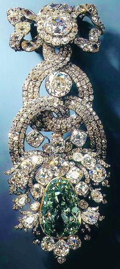 """The Dresden Green Diamond is a 41 carats (8.2 g) natural green diamond, which probably originated in the Kollur mine in the state of Andhra Pradesh in India. In 1768, the diamond was incorporated into an extremely valuable hat ornament, surrounded by two large and 411 medium-sized and small diamonds. This is the setting that the Dresden Green still appears in today. Today, the diamond is shown in the """"New Green Vault"""" at Dresden Castle."""