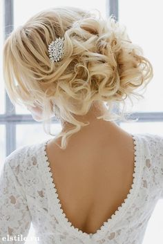 Classy updo wedding hairstyle idea; Featured: Elstile