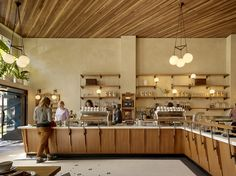 """Boor Bridges Architecture has become a go-to design firm for third-wave coffee establishments in San Francisco. In addition to Sightglass 20th Street, it counts The Mill, Four Barrel Coffee, and Sightglass's first location in SOMA in its portfolio of cafes and shows no signs of slowing down. """"The third wave coffee trend has allowed us to explore many of our design interests, including crafted and intricate custom details and lighting, honest and exposed materiality, adaptive reuse of…"""
