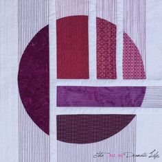 This quilt continues the color series I have been working on within Mini Quilt Mania. While other quilts in this series have the color distributed across the piece, the violet circle in this quilt cre