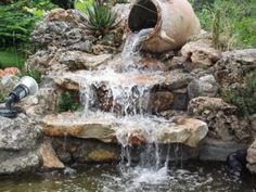 fotos de estanque con cascada                                                                                                                                                      Más