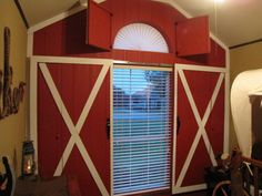Cowboy Room, the barn doors slide open and shut to open and shut the windows. Great for a kid room