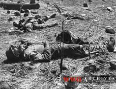 World War II Photograph: An American Marine, in foreground, still clutches the knife with which he killed a Japanese soldier, in background, in a duel on Engebi Island, Eniwetok Atoll. A moment after finishing off his adversary, a sniper's bullet killed the Marine.
