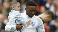 Terminally ill fan appears as England mascot with his idol Jermain Defoe.