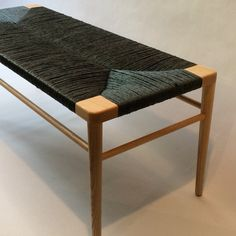 Our RLB44 woven rush Bench in ash with black rush.