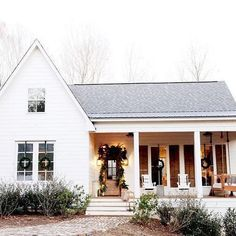 Warm weather, a good book, and that cozy porch swing is what we're daydreaming about @hammmadefurniture's home has some major curb appeal (regardless of the temperature ☺️)! #mycountryhome #curbappeal #onetofollow #farmhouse #FarmhouseLandscape