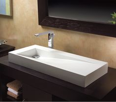 Its beauty lies in the clean lines and simple shape. The St. Tropez lavatory sink appears to have been chisled into its final form. For more products from MTI check out ibathtile.com.