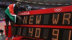 David Lekuta Rudisha of Kenya points to his 800m world record time