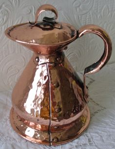 A most attractive Early 20th Century Antique English Edwardian Hammered Copper Lidded Jug of quart capacity, which, despite it's cover being a little loose, offers an altogether excellent example of Arts and Crafts medieval style metalwork.