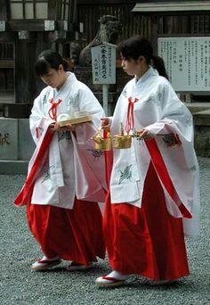 Miko ( shinto priestess ) at Aso shrine in Aso ,Japan