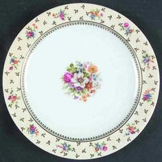 """Carousel"" china pattern with pastel yellow rim & floral accents from Raynaud."