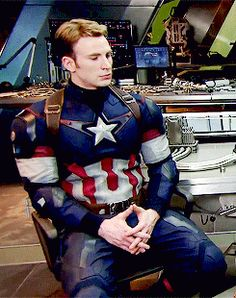 Can't tell if this is Cap or if it's Chris dressed as Cap in between shots.------------------------- If there's one thing I can tell, it's that he's bored.