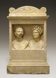 "Marble funerary altar with portrait busts of a man and a woman. The inscription under the niche provides the identity of the two busts: Dis Manibus / L(uci) Caltili Stephani / Caltiliae Moschidis, meaning ""To the souls of the deceased, of Lucius Caltilius Stephanus and Caltilia Moschis"".Most of the man's face is ruined, while the portrait of the woman is missing only the tip of the nose. The woman's hairstyle corresponds to the fashion of the ladies from ..."