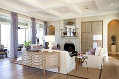 living rooms - coffered ceiling wall French doors lilac silk drapes demilune cabinet white slipcover sofa chairs pink trellis pillows tan walls