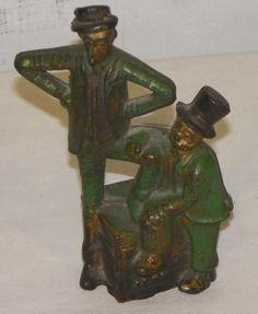 """Cast Iron Bank - Mutt & Jeff green paint     Cast Iron Bank Mutt & Jeff - Original green paint . Measures 5 1/4"""" x 2 1/4"""" Height. -  $350 (59782 bytes)"""
