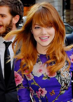 Emma Stone- love the color and cut, but probably too bright/orange for me