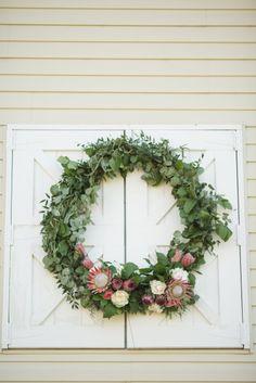 Pretty wreath: http://www.stylemepretty.com/2015/04/21/rustic-chic-farmhouse-wedding/ | Photography: Katelyn James - http://katelynjames.com/