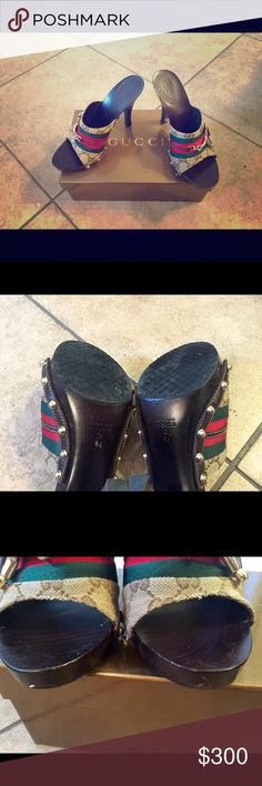 Gucci Clogs GG fabric clogs with gold tone bit and hardware with wooden heel. Very good condition, worn only a few times. A few marks as shown in front but you can't see when on. Comes with original box. Final sale , as is!. Great shoes!!!! Gucci Shoes Sandals