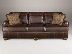 Signature Design by Ashley - Traditional Leather Sofa w Accent Pillows