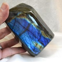 Labradorite. A member of the feldspar family, it has an iridescence and can be semi-opaque. It is said to help you to see through illusions and determine the actual form of your dreams and goals. It is excellent for strenghthening intuition and creativity.
