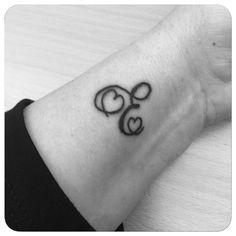E letter tattoo, heart tattoo, mother's tattoo.