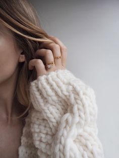 Love this mix - big knitted jumper and minimal gold rings.  Find similar here:  http://asos.do/hp5Trd http://asos.do/vphC5F