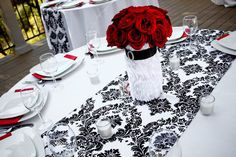 im not one to be plannin my wedding day but im starting to fall in love with the idea of a red black and white color scheme... so beautiful. love this table runner especially!